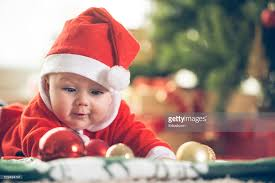 baby boy christmas baby boy with christmas baubles stock photo getty