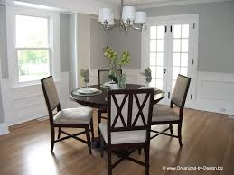 traditional dining room with wainscoting hardwood floors in