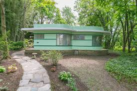 colorful art deco home with lake views asks 250k curbed