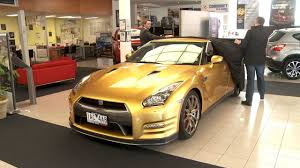 nissan australia managing director nissan delivers rare gold gt r to charity auction winner