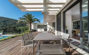 modern beach house design with outdoor dining room sets