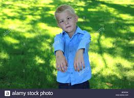 a 5 year boy acting like a stock photo royalty free