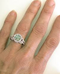 green amethyst engagement ring checkerboard faceted green amethyst and diamond halo engagement