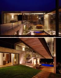 Hillside Home Designs by Hillside House With 2 Concrete Volumes 2nd Story Entrance Bridge