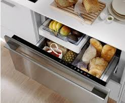 a shallow roll out above a drawer works great for lid storage