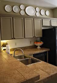 granite countertops above kitchen cabinet decor lighting flooring