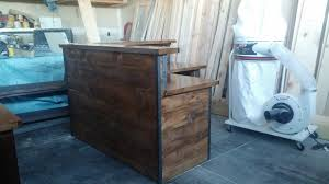 L Shaped Reception Desk L Shaped Reception Desk Done In Rustic Facing With A Metal Edge