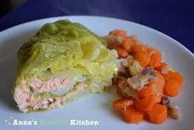haute cuisine recipes stuffed cabbage with salmon on a bed of carrots and bacon s