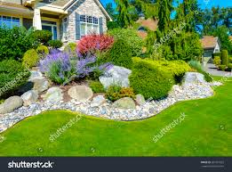 Front Yard Landscape Design by Flowers Stones Front House Front Yard Stock Photo 207757822