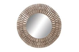 contemporary round wall mirror with champagne iron frame by uma