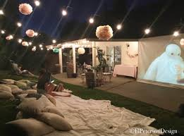 outdoor movie night backyard summer movie lights from fence to