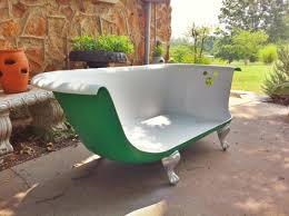 bathtub sofa for sale needs a warmer paint job and a big fluffy cushion otherwise neat