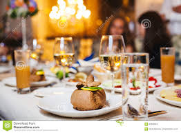 cuisine de a à z dessert dessert on plate at served table glasses with drinks stock photo