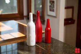 how to make a holiday centerpiece by spray painting glass bottles