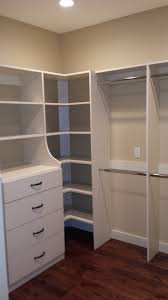 white pine wood closet corner shelving units with storage drawers