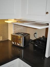 garage door for kitchen cabinet hide your kitchen appliances with a garage style cabinet