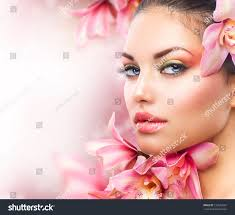 professional make up beautiful girl orchid flowersbeauty model woman stock photo