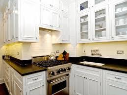white brick backsplash black granite countertop white wooden