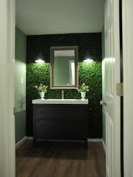 panels of faux boxwood leaves offer an earthy feel to the feature