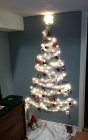 How To Decorate A Christmas Tree The No Tree Christmas Tree Wall Christmas Tree Small Spaces And