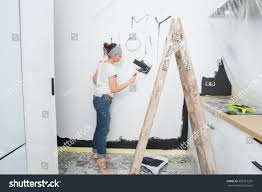 woman paint wall home stock photo 359312255 shutterstock