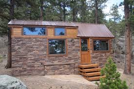 tiny homes on wheels explore simple bliss with this gorgeous stone cottage on wheels