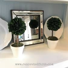 Topiary Balls With Flowers - diy topiary trees with tiered boxwood balls perfect for any season