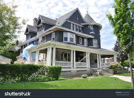 suburban three story tall victorian home stock photo 103145366