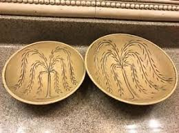 two wooden bowls incised with weeping willow tree design folk