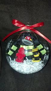 4in blown glass fireman ornament by noturordinaryornamnt on etsy