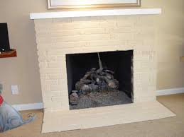 painted brick fireplace brick fireplace with wooden mantle