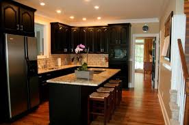 Island In A Kitchen Black Cabinets In Kitchen Cutting Fieldstone Of Island Finishing