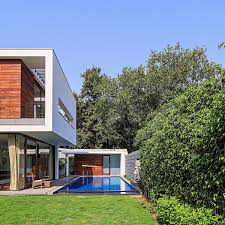 small pool house wooden slats glass walls and modern grandeur gallery house in india