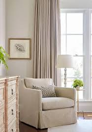 elegant bedroom reading corner with skirted herringbone chair and