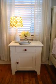 small bed side tables with modern double drawers as storage and