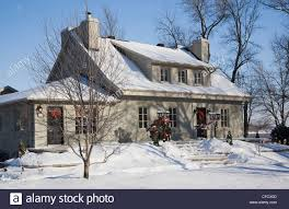 residential home with christmas decorations in winter quebec