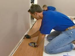 Snap Together Laminate Flooring How To Install Underlayment And Laminate Flooring How Tos Diy