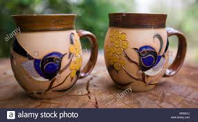 two decorative and unique hand crafted coffee mugs with highly