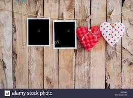 two heart and two photo frame hanging on clothesline with