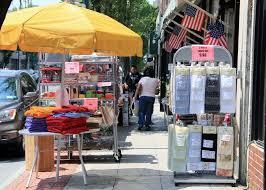 new rochelle now get down downtown sidewalk sale success