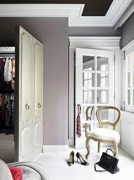 gray fabric closet door with silver nailhead trim contemporary