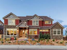 a view of the exterior of an craftsman style home that is red with