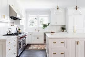 white kitchen cabinets with glass cup pulls white kitchen with brushed gold cup pulls transitional