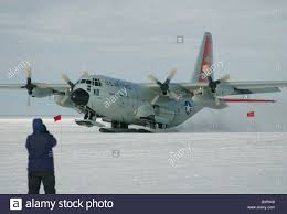 ski equipped lockheed lc 130 hercules aircraft taking off from the