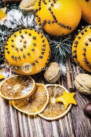 dried oranges with nuts and fir branches christmas decorations