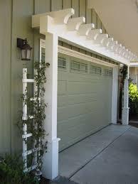 garage doors hanging baskets dress up garage arbor curb appeal