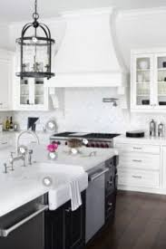 black pulls for white kitchen cabinets 13 kitchen hardware trends for 2021 the flooring