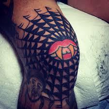 web tattoo on knee