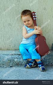 cute baby boy guitar sitting against stock photo 103390364