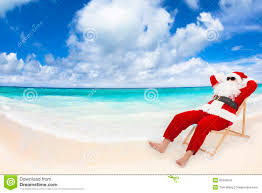 santa claus sitting on beach chairs christmas holiday concept
